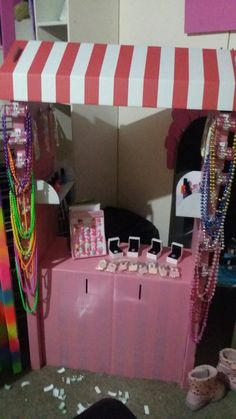 Unfinished fashion boutique stall. Plastic hooks stuck on sides to hold necklaces