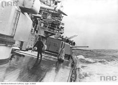 11 in pocket battleship (officially 'panzerschiffe') Admiral Scheer at sea during her long Atlantic commerce raiding cruise, October 1940 - March 1941, during which she famously sank the armed merchant cruiser Jervis Bay.  This shot shows her single mounting 5.9 in secondary guns and 4.1 in dual purpose tertiary guns.  Later re-classified as a heavy cruiser, she capsized under RAF bombing at anchor in April 1945.