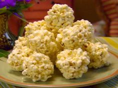 Paula Deen's Popcorn Balls Recipe - - Homemade popcorn balls are easy to make. Just pop some popcorn, make the caramel and mix. Make sure to lightly grease your hands so the popcorn doesn't stick to your. Honey Popcorn, Marshmallow Popcorn, Pop Popcorn, Carmel Popcorn, Chocolate Popcorn Balls Recipe, Halloween Popcorn Balls Recipe, Popcorn Cake, Perfect Popcorn, Popcorn Snacks