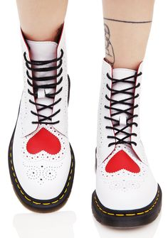 Dr. Martens Bentley Heart Brouge 8 Eye Boots there ya go again, breakin' their hearts! These sikk Docs feature a smooth white leather construction with brogue style detailing all over, treaded soles with signature yellow stitching, cushioned footbed, red heart cutout on the toe, and full length lace-ups.