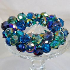 #Vintage Blue Green AB Glass Bead Bracelet. Dark AB Glass Crystal Beads Bracelet. Cha Cha Bracelet.  This vintage blue green AB glass bead  bracelet is fabulous!  It features a cha cha style stretch bracelet filled with round faceted blue green glass beads with an aurora b... #etsy #vintage #antique #shopping #christmas #jewelry #jewellery