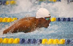 Lochte competes in the men's 50m butterfly final during the 2012 Charlotte UltraSwim Grand Prix