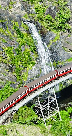 Cairns, Australia. Take a 75-minute ride on the historic and picturesque Kuranda Scenic Railway past cascading waterfalls and through mountain-carved tunnels.