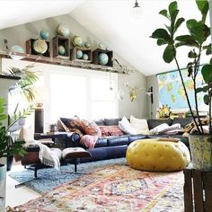 Quirky, colorful living room with prints and plants