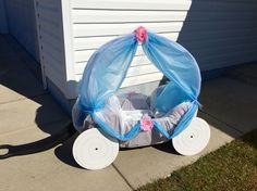 Cinderella carriage for Halloween. Using hula hoops, table clothes, tulle, and lots of hot glue, our wagon was transformed into a carriage for our baby princess. The wheels are 14 inch cake cardboard.