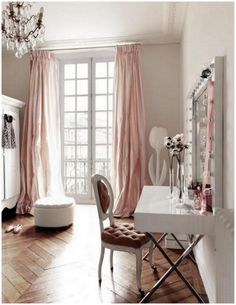 Love the herringbone floors, full pink silk draperies, and crystal chandelier!