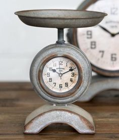 """This adorable scale shaped clock is perfect for your farmhouse kitchen! Looks great with industrial and modern country decor too! Stands 9.5"""""""" high. Scale pan is 7.75"""""""" in diameter and clock is approx"""