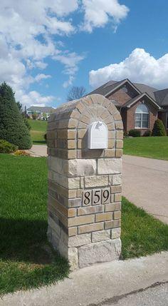 Stone and brick mailbox built on Whitmoor golf course by chesterfield masonry / masterpiece masonry.
