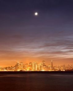 The moon setting over San Francisco on a hazy December evening, taken from Treasure Island.