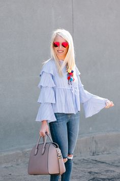 I love a great statement top and this ruffled pom pom blouse meets all the requirements!