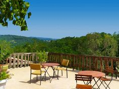 Terrace with stunning view overlooking  the Cevennes at Mas de Bourlenc Guesthouse in Ardeche