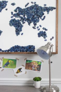 How to repurpose old puzzles with missing pieces into a beautiful statement piece of map wall art. Includes tips on two methods for attaching the stained frame.