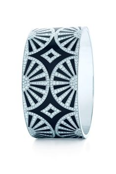 A show of fans unfolds with Art Deco's strikingly clean lines. Diamond bangle with black lacquer in platinum by Tiffany & Co.