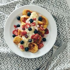 French toast with strawberries, blueberries, puding and chia seeds.