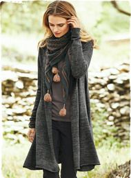 Gossamer light and soft as a cloud, our charcoal cardigan is a modern classic, engineered with a shawl collar, slim sleeves and godet side panels for a flowy, flared silhouette. Baby alpaca (65%), silk (16%), nylon (16%) and wool (3%).