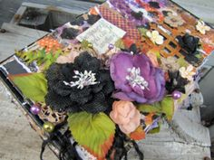 Here is a close up of the flower cluster on Lynne Forythe's altered cigar box.  She has mixed Botanica Blooms, Burlap Blooms, and crocheted lace to create these beautiful flowers!  In addition, she has run these flowers down the front of the box and on to the sides too!  Come to the Petaloo Blog and see how she does it!