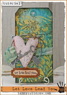 Tammy Tutterow Tutorial: Let Love Lead You art tag featuring products by Tim Holtz, Ranger Ink, and Sizzix.