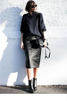 sneakers and pearls, street style, black leather skirt with a thick knit and black leather ankle boots, trending now.jpg