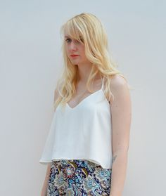 Cream double layered swing crop top, available in sizes XS-L on www.thewolfflower.com