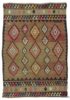 Vintage kilim rug hand-woven in Balikesir, Turkey in 1960's. This attractive tribal kilim is in very good condition.