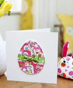 Simple Easter card made out of wrapping paper and ribbon.