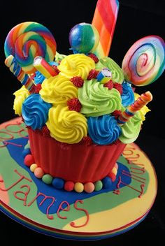 big cupcake idea...reminds me of Willy Wonka & the chocolate factory garden!