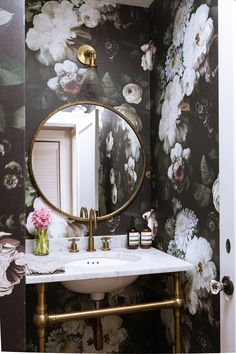 The powder room features wallpaper by Ellie Cashman.