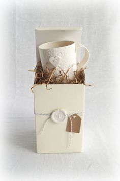Beautiful packaging for a beautiful lace porcelain mug by VanillaKiln ceramics #vanillaKiln #ceramics #porcelain