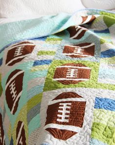Football quilt by Cluck Cluck Sew Quilting Projects, Quilting Designs, Sewing Projects, Quilting Ideas, Quilt Design, Football Quilt, Sports Quilts, Cluck Cluck Sew, Baby Boy Quilts
