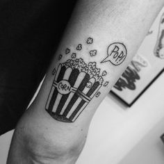 A box of popcorn. | 36 Beautiful Tattoos For People Who Love Food