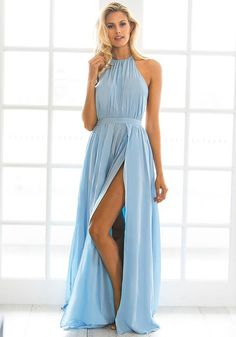 Angled view of  model in powder blue M-slit halter dress