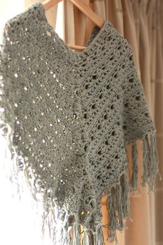 Poncho. The pattern (diagram) is free and can be found here:  http://gosyo.co.jp/english/pattern/eHTML/poncho_cape.html