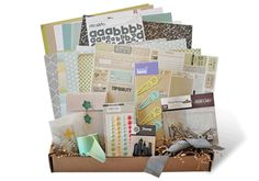 Scrapbook kit contents in a pizza box