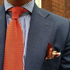 This beautiful rusty orange knit tie beautifully complements a pocket square and an elegantly substantial lapel. #giftlab