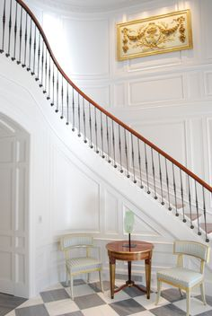 Grand entrance.  Love the wall moulding!  Love the grey tiles...a more subtle version the classic checkerboard pattern.