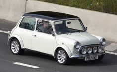 Austin Mini 1000, mini was a real basket case, all white color .. every fluid leaked out of that car, and rusty as heck.