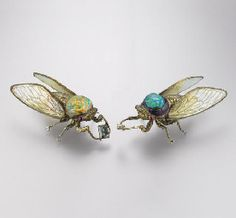 A PAIR OF DELICATE MULTI-GEM AND COLOURED DIAMOND BROOCHES, BY WALLACE CHAN