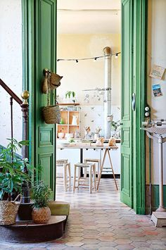 Tall green doors inside 12th-century french chateau