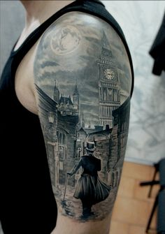 Moon and streets of UK tattoo on arm