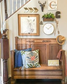 Eclectic Home Tour - love this bench that looks like an old church pew and the gallery wall above kellyelko.com