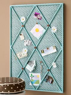 Make this cute fabric-covered bulletin board to match your home's decor. Cut a piece of plywood the same size as a window insert purchased at a home center. Cover the plywood with cork and batting. Wrap fabric around to the back of the plywood and secure the edges with a staple gun. Paint the window insert, and nail to the plywood when dry, and
