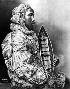 B. B. Dobbs, Native Man in Gut Parka with Small Carved Boat, Nome, Alaska