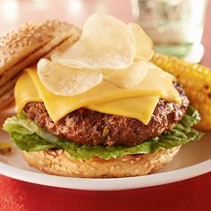 Pickle relish, tomato and mustard beef up these burgers before they ever hit the grill. Top with cheese and potato chips for the ultimate burger experience.