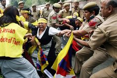 Indian policemen restrain a Tibetan woman during a demonstration at the Chinese Embassy in New Delhi on March 12, 2008 on the occasion of the Tibetan Women's Uprising Day. Some 49 Tibetan women, holding Tibetan flags attempted to enter the Chinese embassy premises in a protest marking Tibetan Women's Uprising Day.