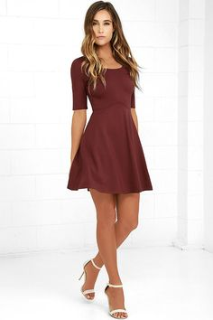 The Black Swan Braelynn Wine Red Skater Dress will earn you some major bragging rights! Medium-weight stretch knit forms a darted bodice with a rounded neckline and fitted half sleeves. A curving waistline adds cute detail above a flaring skirt. Hidden back zipper.