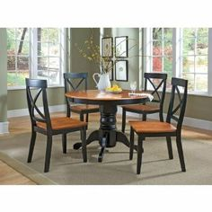 Dining chair is made of a solid hardwood. Comes with black and cottage oak finish. Cross back design. Includes two chairs per set. Easy to assemble. Seat measures 18-inch in height. Measures 19-1/4-inch width by 22-1/2-inch depth by 38-inch height.