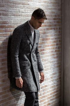 Slim-fit double-breasted #Coat with lance rever, central slit and martingale with quilted interior made of macro carded grisaille tweed.  Available on our online store...  #coats #outerwear #sales #fw18