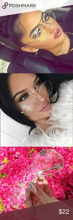 Clear Lens Aviator Sunglasses Perfect sized, and super trendy clear Aviators are this seasons must have accessory! Available in gold, black and silver frames. Accessories Sunglasses