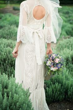 gorgeous back details on this #lace #gown | Lavender Farm Inspiration from Adorne Artistry + Gary Guy Photographer  Read more - http://www.stylemepretty.com/texas-weddings/2013/10/29/lavender-farm-inspiration-from-adorne-artistry-gary-guy-photographer/