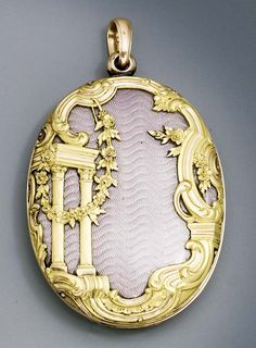 A two-color gold-mounted guilloché enamel locket  maked Fabergé and with the workmaster's mark of Henrik Wigström, St. Petersburg, 1896-1908, with scratched inventory number 29592 Oval, the two sliding panels enamelled in translucent lilac over a moiré gound and mounted à cage, the front cover with architectural devices, a floral garland and sprays amidst a rocaille and foliate scroll openwork border, the reverse with flowersprays, rocaille and foliate scroll border